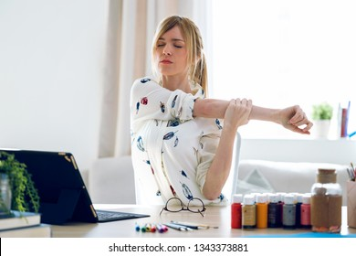 Shot of business young woman stretching body for relaxing while working with digital tablet in the office.