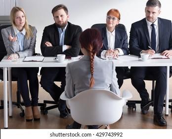 Shot of businessmen interviewing a job applicant