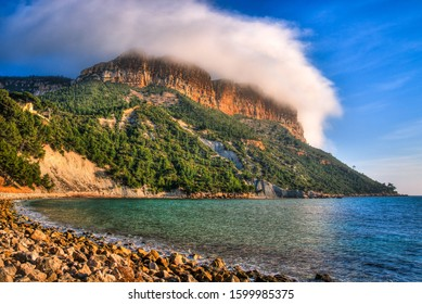 Shot of Cap Canaille in Cassis covered by a hat shaped orographic stratus cloud