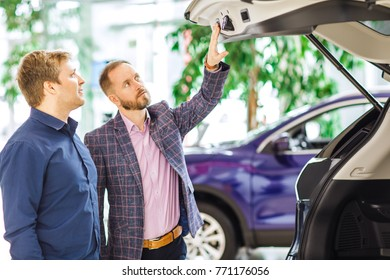 Shot of a car dealer showing trunk of the car to his male client copyspace communication consultation drive travelling people lifestyle buyer salesperson business vehicle consumerism retail.