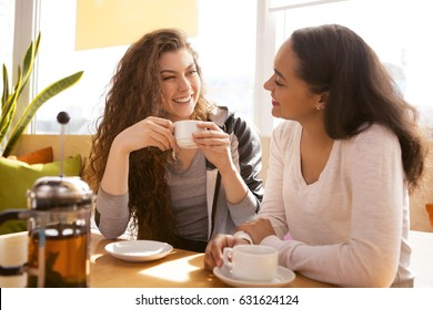 Shot of cheerful girlfriends spending time together at the cafe talking and laughing happily coffee shop tea drinking drink beverage lifestyle meeting friendship teenager communication diversity relax