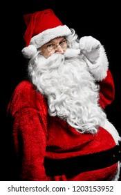 Shot of cheerful santa claus at studio shot