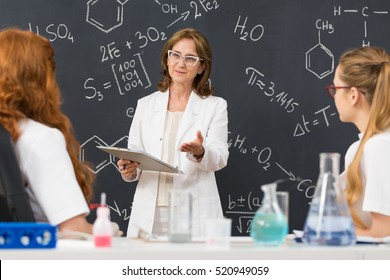 Shot of a chemistry professor giving a lecture to her students