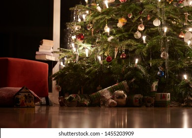 shot of christmas decoration hanging on a christmastree and some presents lying beneath it