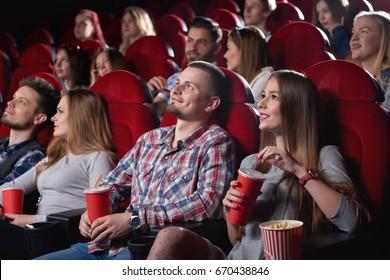 Shot of cinema auditorium full of spectators enjoying watching a movie people lifestyle leisure entertainment happiness positivity emotions concept.
