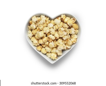 Shot of cinema style popcorn in a heart shaped bowl isolated on a white background with a clipping path and copy space for the designer.