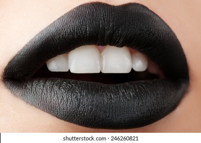 Shot close-up black matte lips