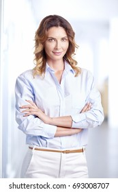 Shot of a confident young businesswoman standing with arms crossed at the office.