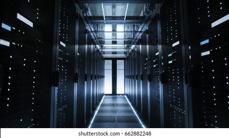 Shot of a Corridor in Large Working Data Center Full of Rack Servers and Supercomputers.