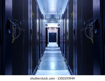 Shot of Corridor in Working Data Center Full of Rack Servers and Supercomputers. concept of big data storage and cloud computing technology.