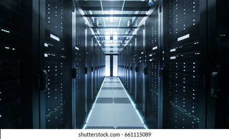 Shot of Corridor in Working Data Center Full of Rack Servers and Supercomputers.