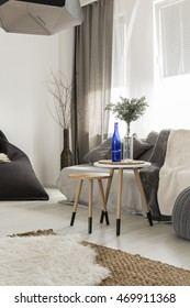 Shot of a cosy living room interior, designed in grey tones