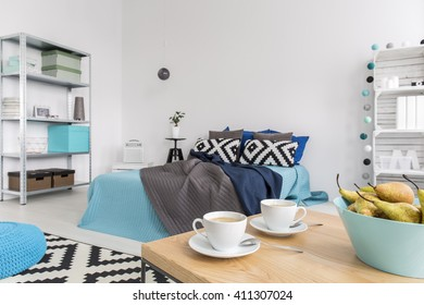 Shot of a cosy modern bedroom with blue decorations