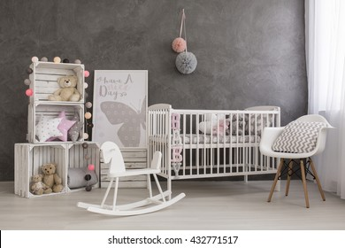 Shot of a cozy baby girl nursery room
