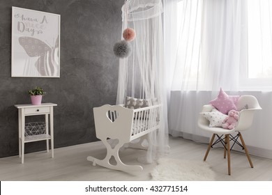 Shot of a cozy baby girl room with a big window