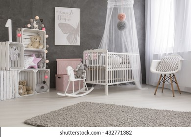 Shot of a cozy and modern baby girl room