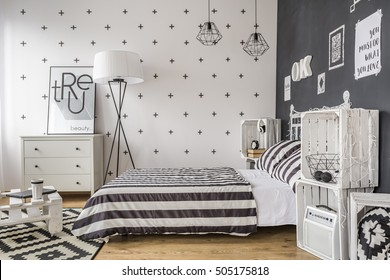 Shot of a creatively decorated black and white bedroom