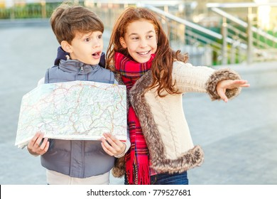 Shot of a cute young girl pointing away showing somthing to her brother while sightseeing together cute boy looking shocked holding a map copyspace emotions experience memories travelling