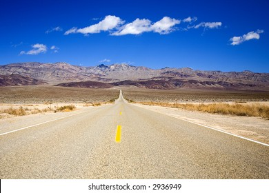 Shot of a desolate roadway in the desert of Death Valley, California.