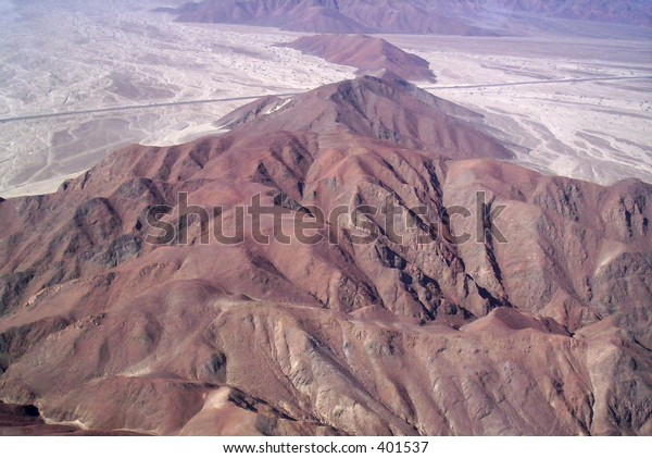 a shot of the dessert and mountains in nasca, peru (arial shot)