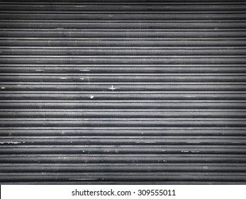 Shot of a dirty, messy, grungy metal roller shutter in typical to urban environments. The image has copy space for the designer to add graffiti style type for example.