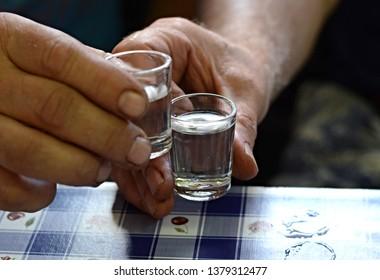 Shot drink in hands