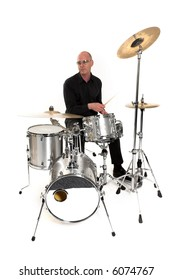 shot of drummer playing over white backdrop
