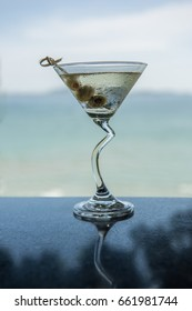 Shot of Dry Martini with seascape background