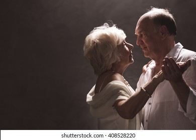 Shot of an elderly couple dancing and looking each other in the eyes