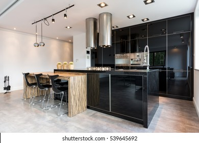 Shot of an elegant open kitchen room with a dining area