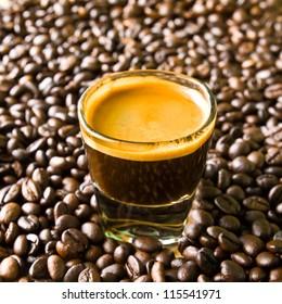 A shot of espresso on coffee bean