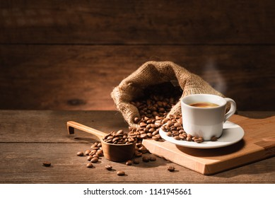 A shot of espresso with roasted coffee bean bag and wooden spoon