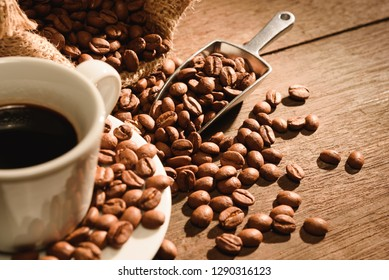 A shot of espresso with roasted coffee bean