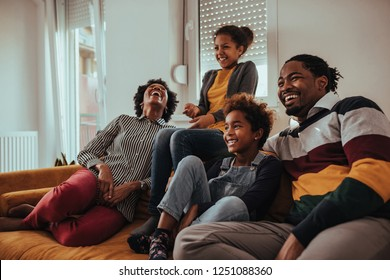 Shot of a family watching television together at home