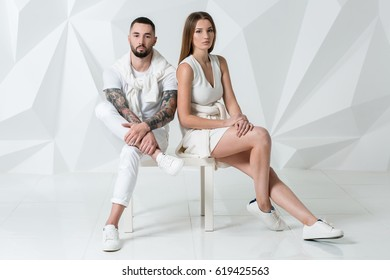 Shot of a fashionable couple posing at studio.