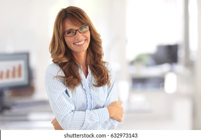 Shot of a female investment advisor businesswoman standing in the office.