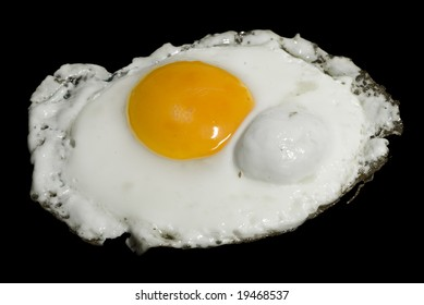 A shot of a fired egg isolated on black