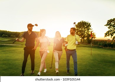 Shot of four people out on a double date on a golf course