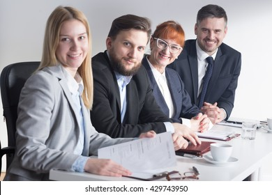 Shot of four smiling recruiters at work