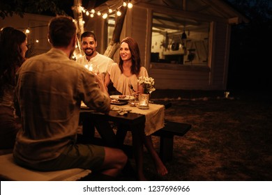 Shot of friends having fun at a dinner party in a backyard