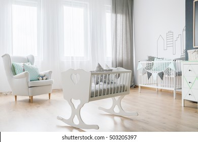 Shot of a full of light child's room with a white crib