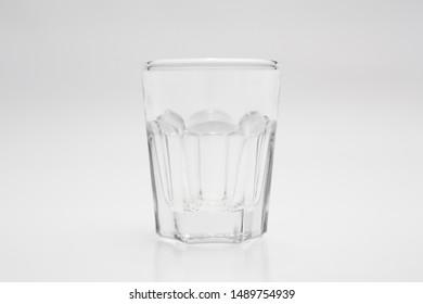 Shot glass on white background