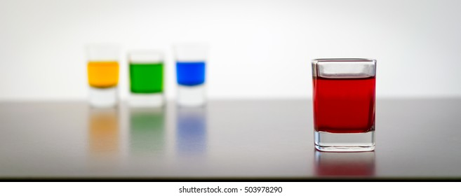 Shot Glasses Filled With Assorted Colored Drinks