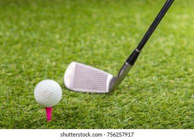 Shot of golf ball with golf club