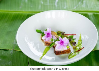 a shot of green curry meat with food decoration and design by food stylist