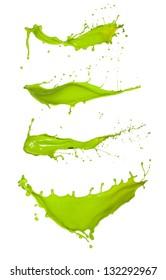 Shot of green paint splashes, isolated on white background