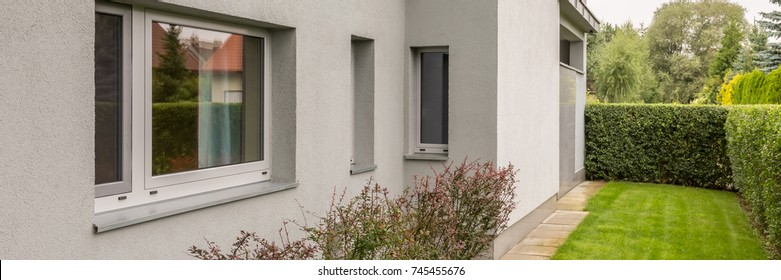 Shot of a grey wall of a detached house