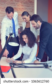 Shot of a group of colleagues working together in an office