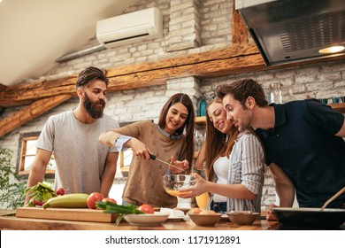 Shot of a group of friends cooking in the kitchen together