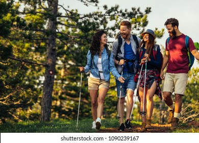 Shot of a group of friends having fun while hiking together through the woods.